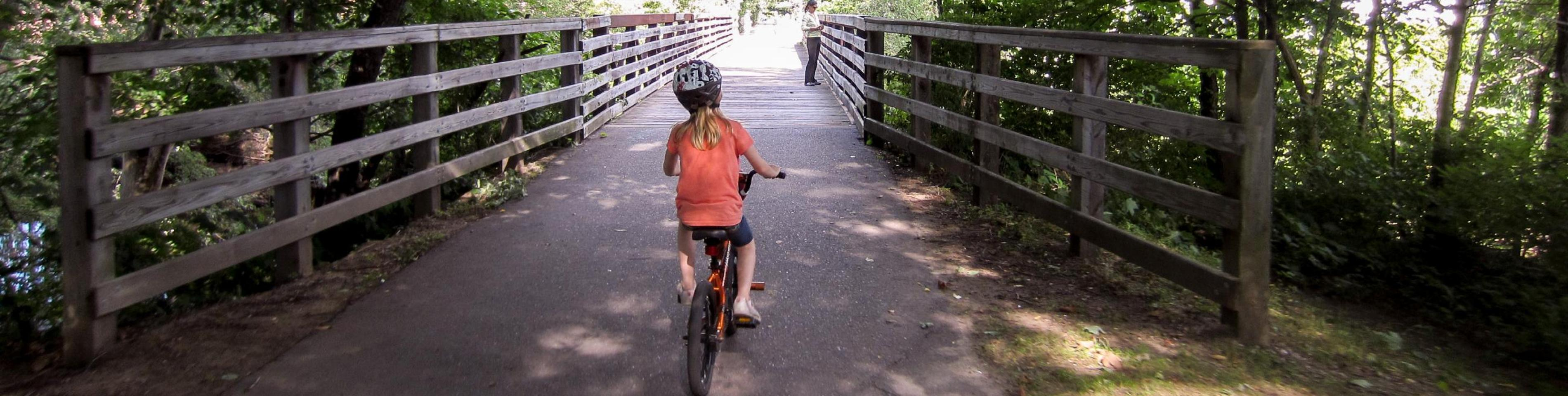 child on bike path